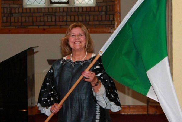 Pastor Sherrie Hadden carrying flag